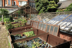9a-X_X_X_Chelsea-Physic-Garden_Greenhouse-Frames_photograher-Unknown_Alans-Garden-Influences