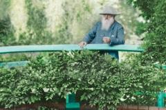 15-Giverny-Garden-France_Claude-Monet-On-His-Bridge_Google-Art-Project_Alans-Garden-Influences
