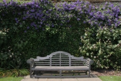 14-Vita-Sackville-Wests-Sissinghurst-Gardens_Bench-Clematis-Flowers_Alans-Garden-Influences